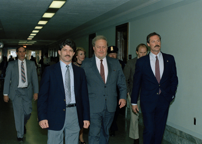 Supreme Court nominee Robert H. Bork, center, walks through a hallway in the U.S. Capitol Building, Oct. 5, 1987, alongside Sen. David Karnes, R-Neb., right. (AP)