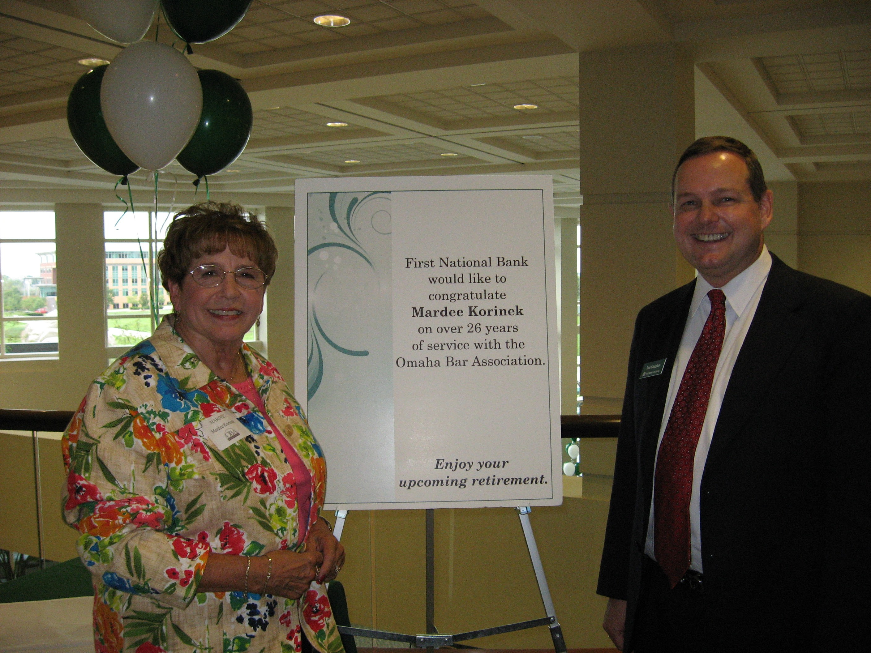 Mardee Korinek, who became Mardee Johnston later in life, celebrates her retirement in 2006 at the Omaha Bar Association Fall Kickoff BBQ with Tom Gaughen of First National Bank. (OBA)