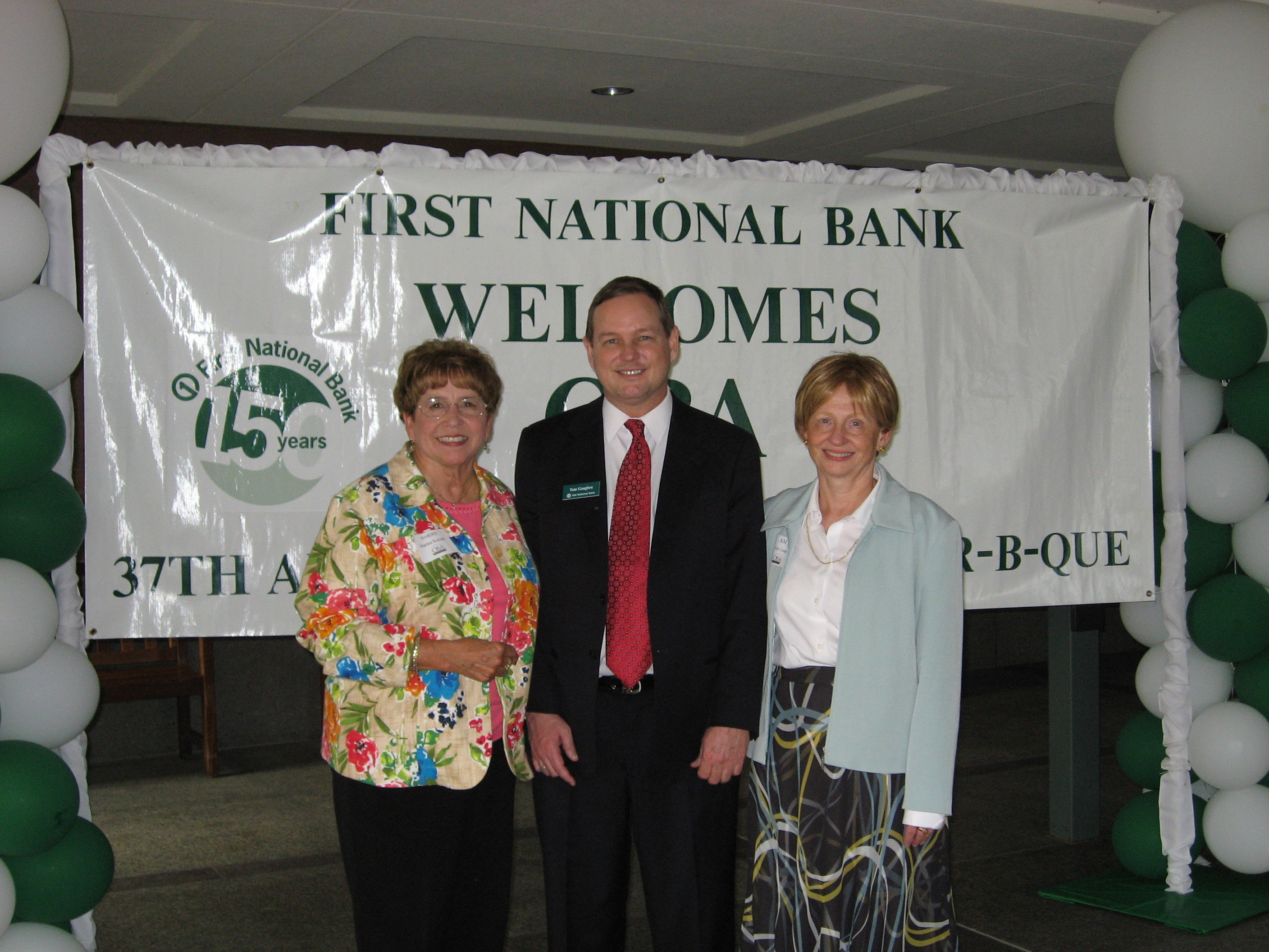 From left, Mardee Korinek, Tom Gaughen of First National Bank and OBA President Amy Longo pose for a photo at the 2006 Omaha Bar Association Fall Kickoff BBQ. (OBA)