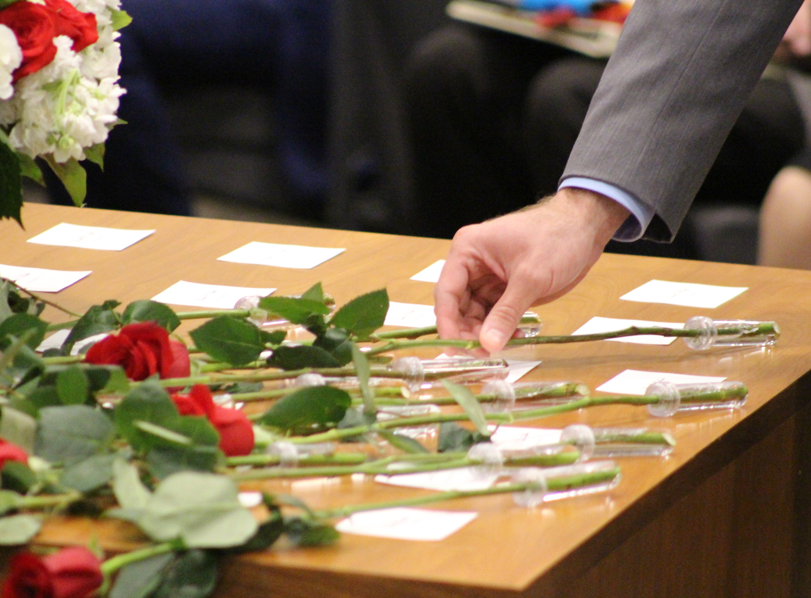 A rose is placed next to the name of an attorney who passed away in 2018-19 during the recognition of the absent at the Omaha Bar Association's annual Memorial Day Program in the legislative chamber of the Omaha-Douglas Civic Center on May 10, 2019. (Photo by Scott Stewart)