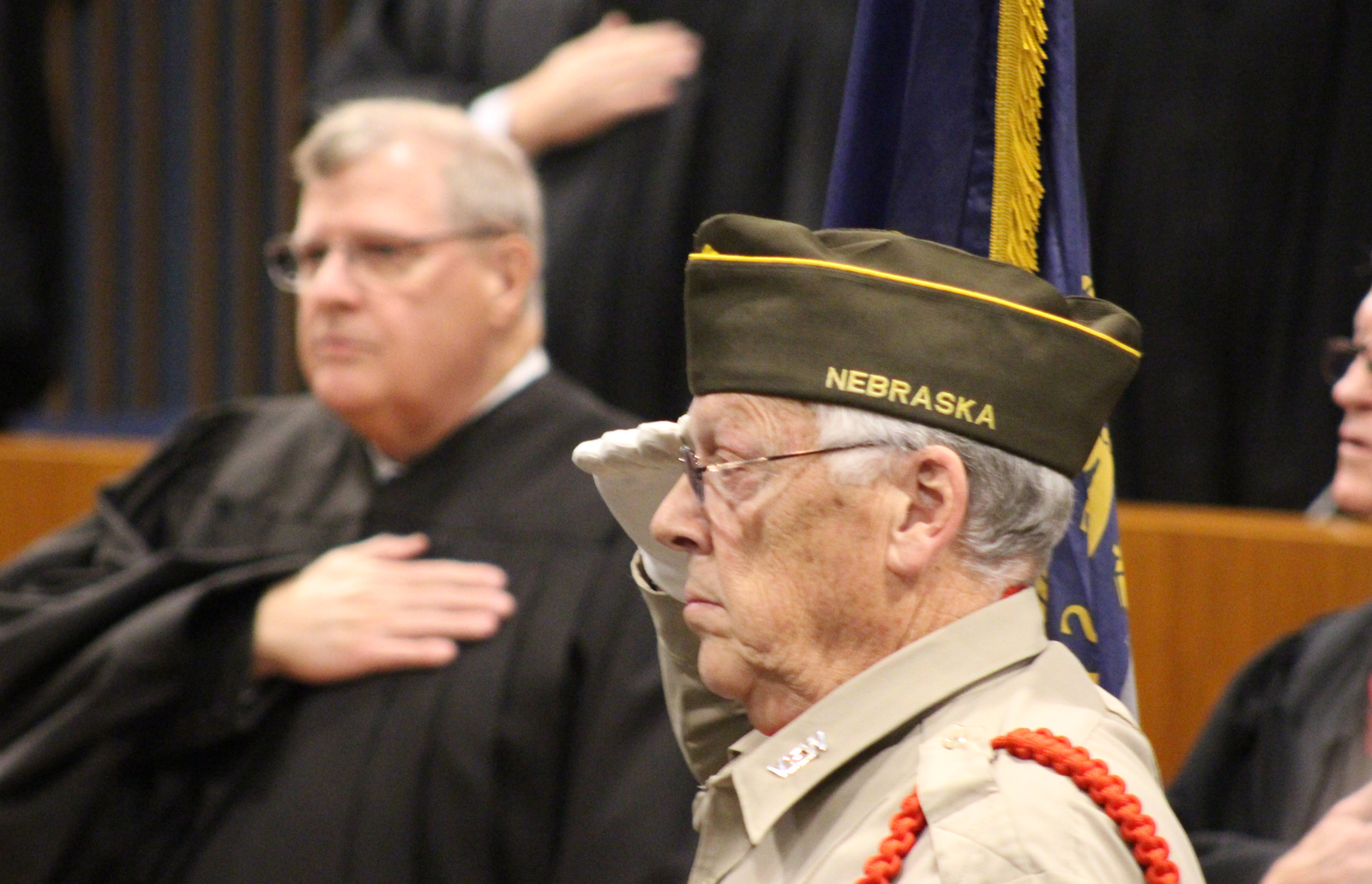 A member of the Benson VFW Post 2503 honor guard salutes the flag during the advancement of the colors at the OBA's annual Memorial Day Program in the legislative chamber of the Omaha-Douglas Civic Center on May 10, 2019. (Photo by Scott Stewart)