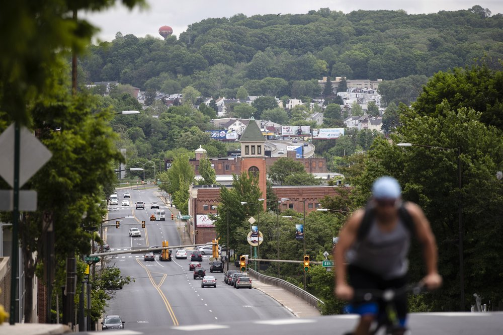 A cyclist pedals up a hill in Allentown, Pa., Friday, May 29, 2020. Allentown predicts a budget deficit of over $10 million, a number officials say could go higher if the economy doesn't rebound quickly. (AP)