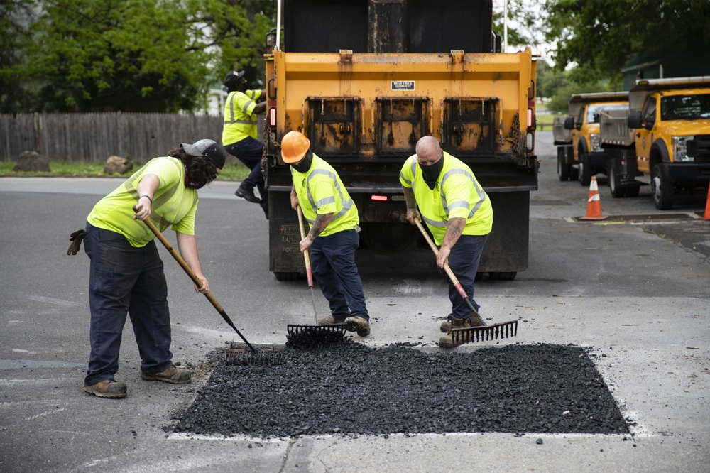 Employees of the Allentown, Pa., streets department patch a hole near Jordan Park in Allentown, Pa., Friday, May 29, 2020. Unfilled potholes, uncollected trash, unmowed grass and, most significantly, fewer police on the street are some of what Allentown says it's contemplating unless Washington helps it plug a multimillion-dollar budget hole left by the coronavirus pandemic. (AP)