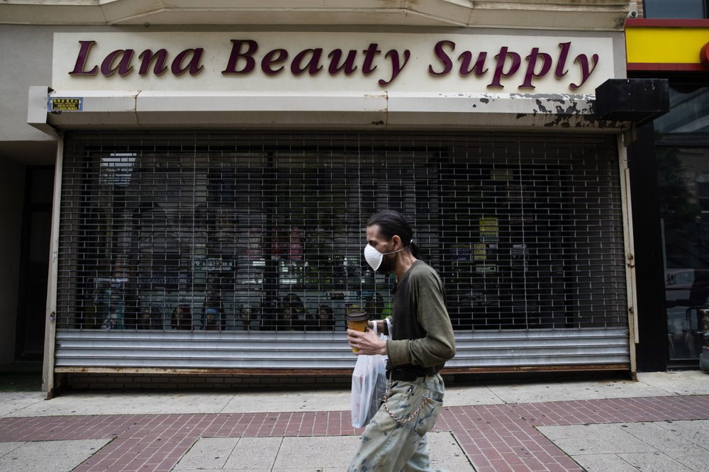 A shopper in a mask walks in front of a shuttered store in downtown Allentown, Pa., Friday, May 29, 2020. Left out of the $2 trillion coronavirus relief package passed by Congress in late March, Allentown and thousands of other smaller cities and counties across the United States have largely fended for themselves amid sharply falling tax revenues. (AP)