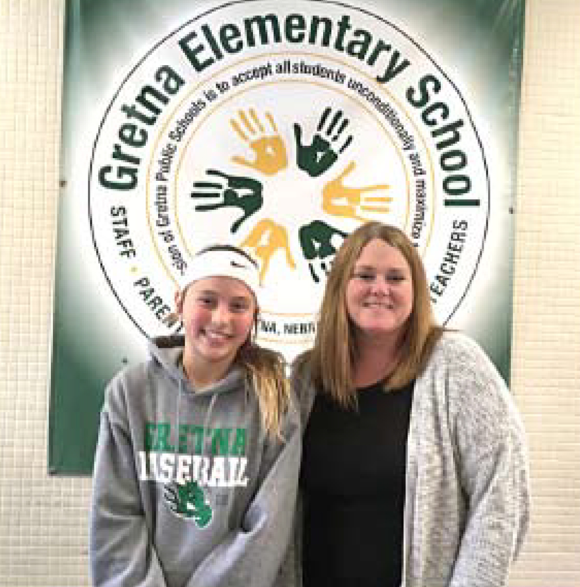 Gretna Elementary School fifth-grader Ellie Melton earns the congratulations of her<br />teacher, Stephanie Bartram, on her first place win in the Poster Contest. Ellie's parents<br />are Charlie and Andi Melton. Her poster is on a billboard near 78th and Dodge Streets. (Photo by Lorraine Boyd)