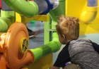 A child plays with a series of tubes at the Omaha Children's Museum during the 10th annual Summer Family Reunification Picnic on June 7, 2019. (Photo by Scott Stewart)