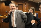 Judge Grant A. Forsberg is helped into his robes by his chil-dren, from left, Seth, London and Devon in the legislative cham-bers of the Omaha-Douglas Civ-ic Center on Friday, Aug. 2, 2019. (Photo by Scott Stewart)